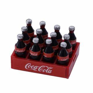 1/10 basa Coca Cola